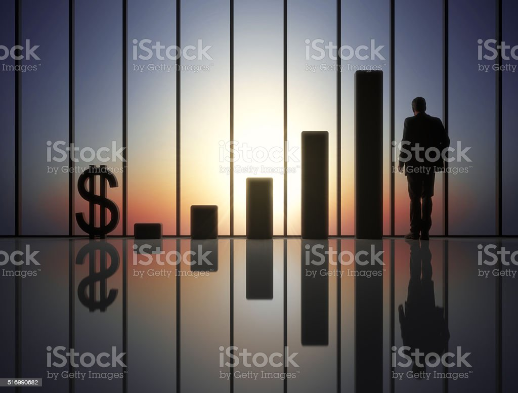 Suited businessman standing at panoramic window in futuristic hall...