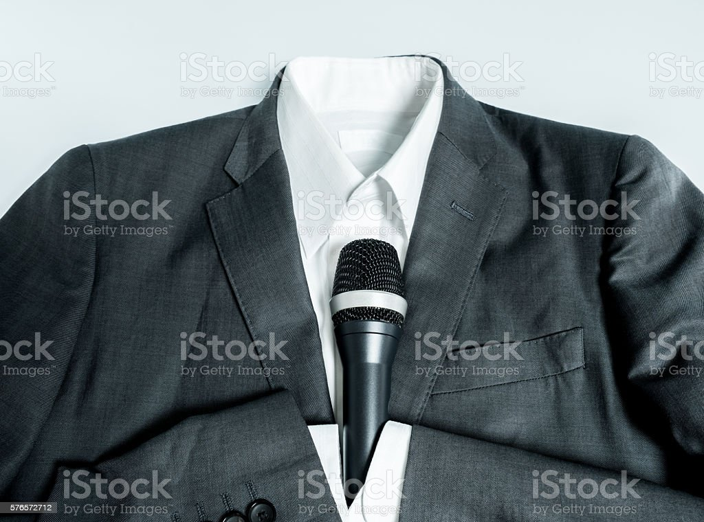 Business suits holding microphone stock photo