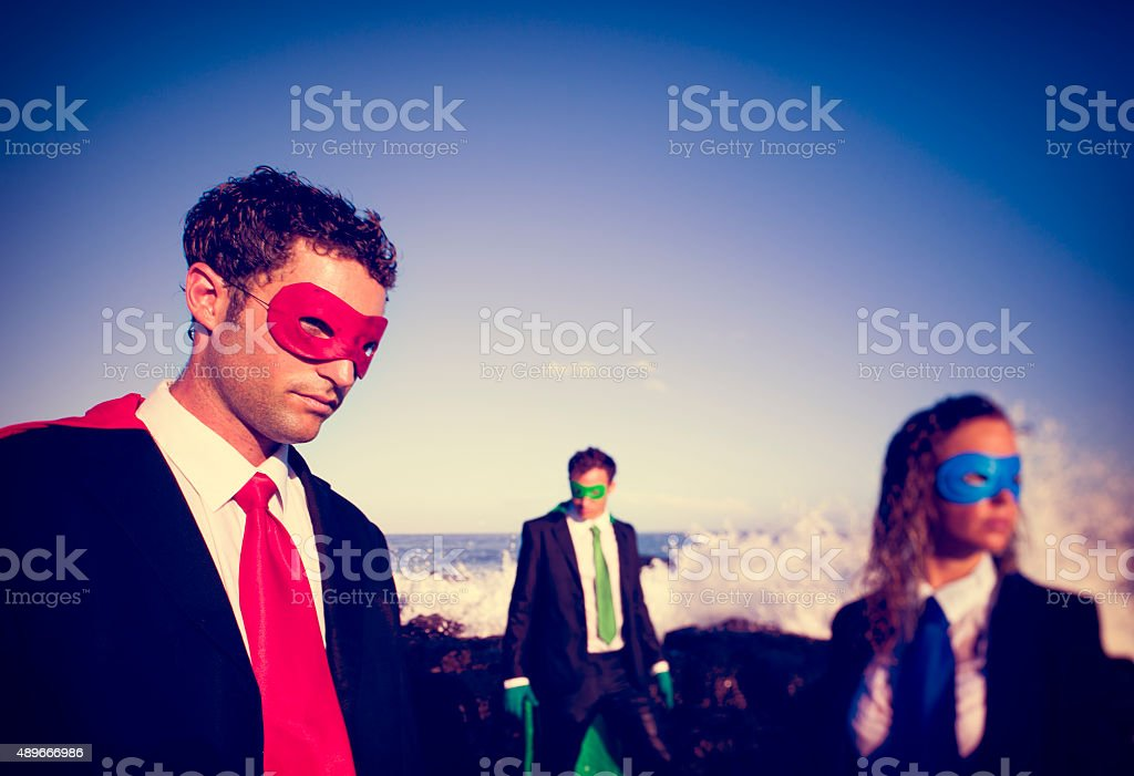 Business superheroes on the beach Confidence Concept stock photo