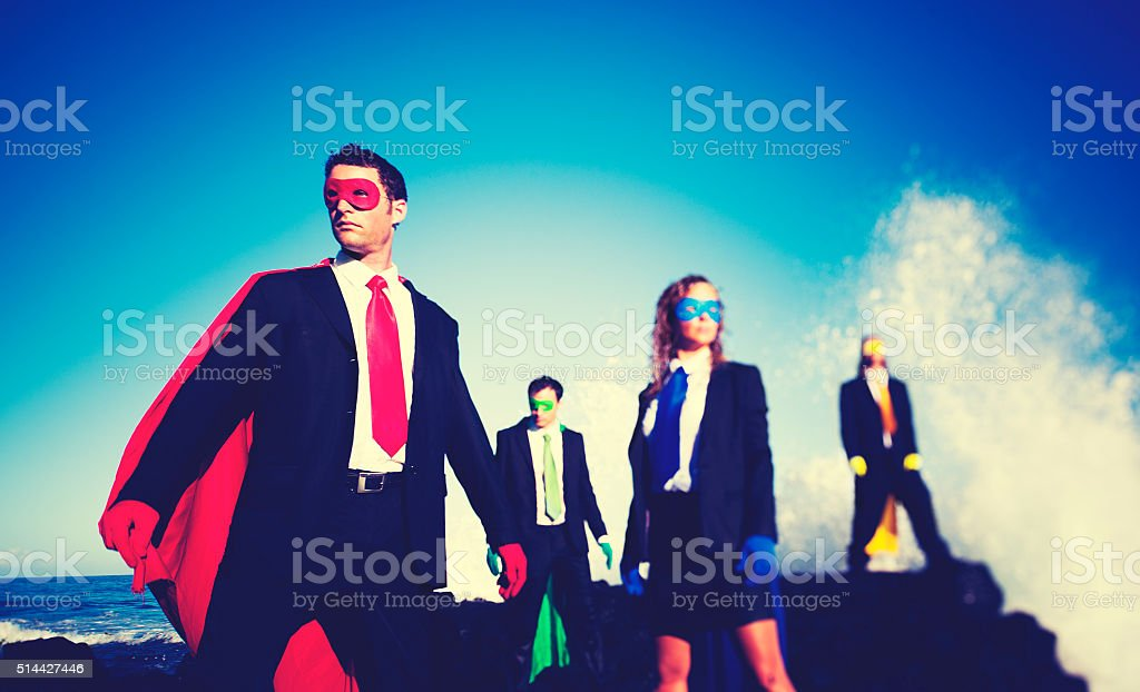 Business superheroes on the beach confident concept stock photo