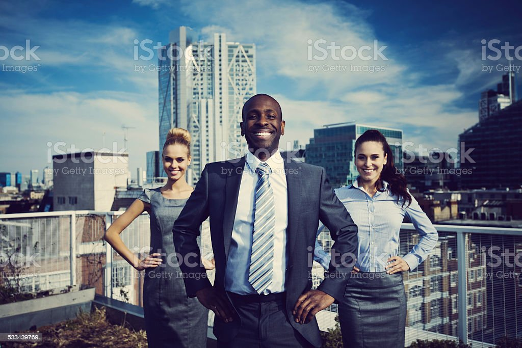 Business Superheroes standing outdoor on rooftop stock photo