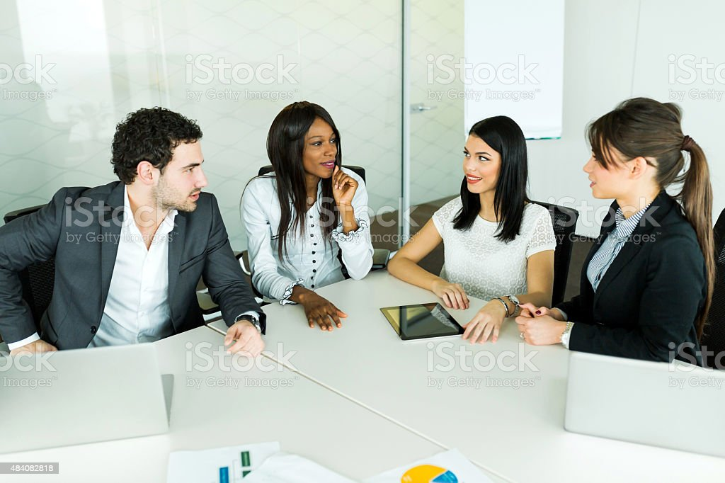 Business talk while sitting at a table and discussing results stock photo