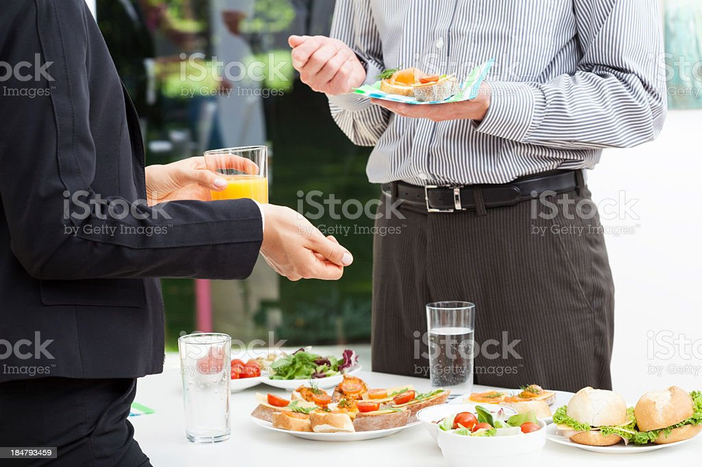Business talks during lunch royalty-free stock photo