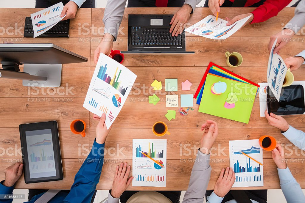 Business team analyzing financial data on a meeting stock photo
