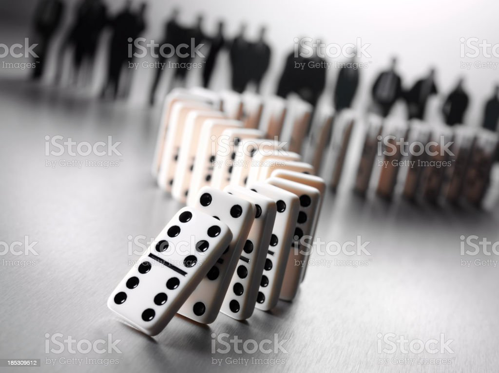 Business Team and Dominoes with a Donimo Effect stock photo