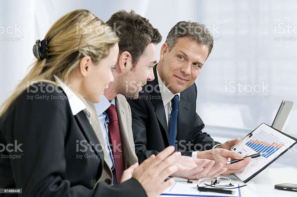 Business team and growing chart stock photo