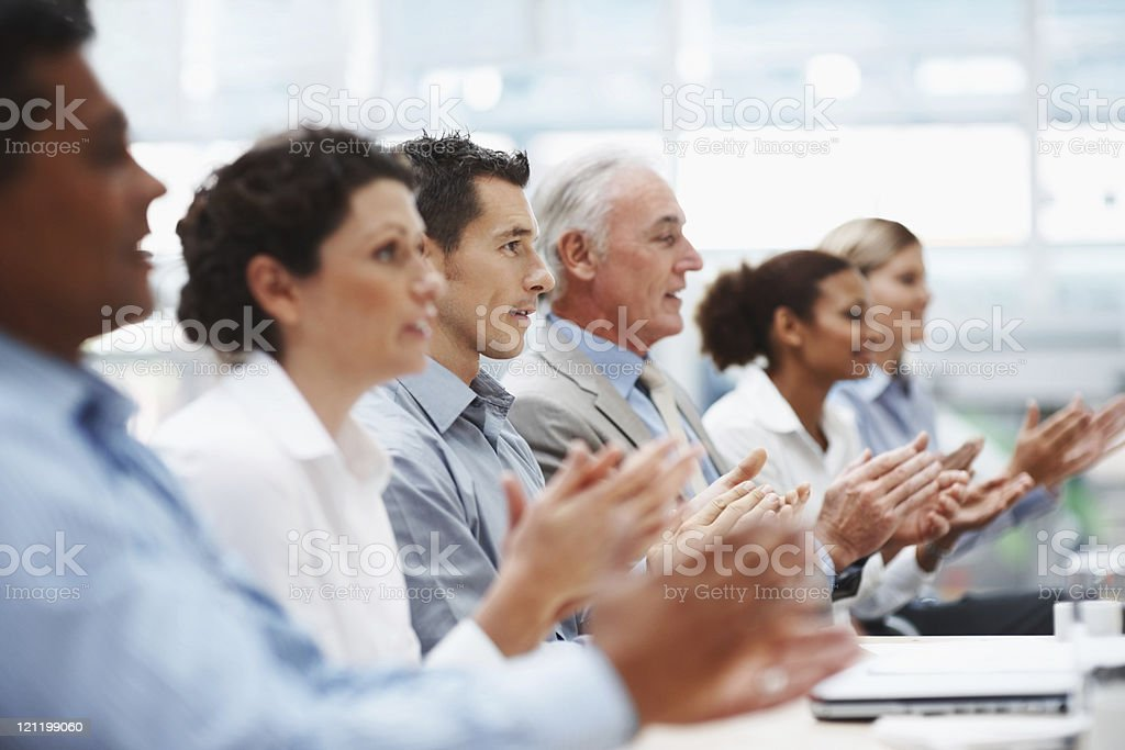 Business team applauding at conference table royalty-free stock photo