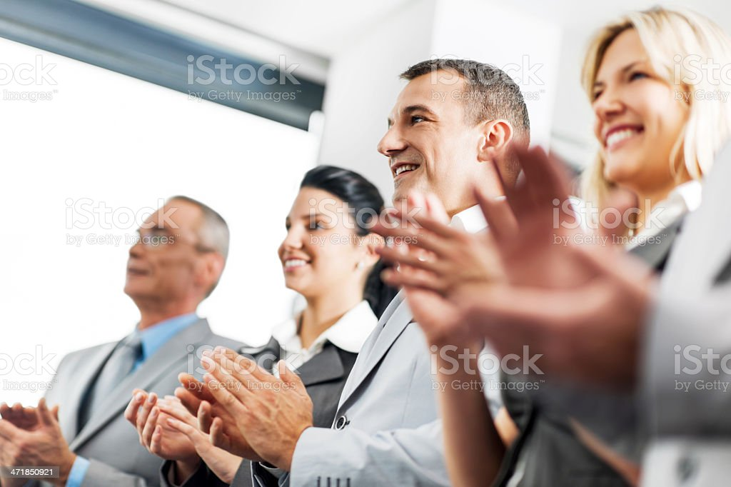 Business team applauding in a row. royalty-free stock photo