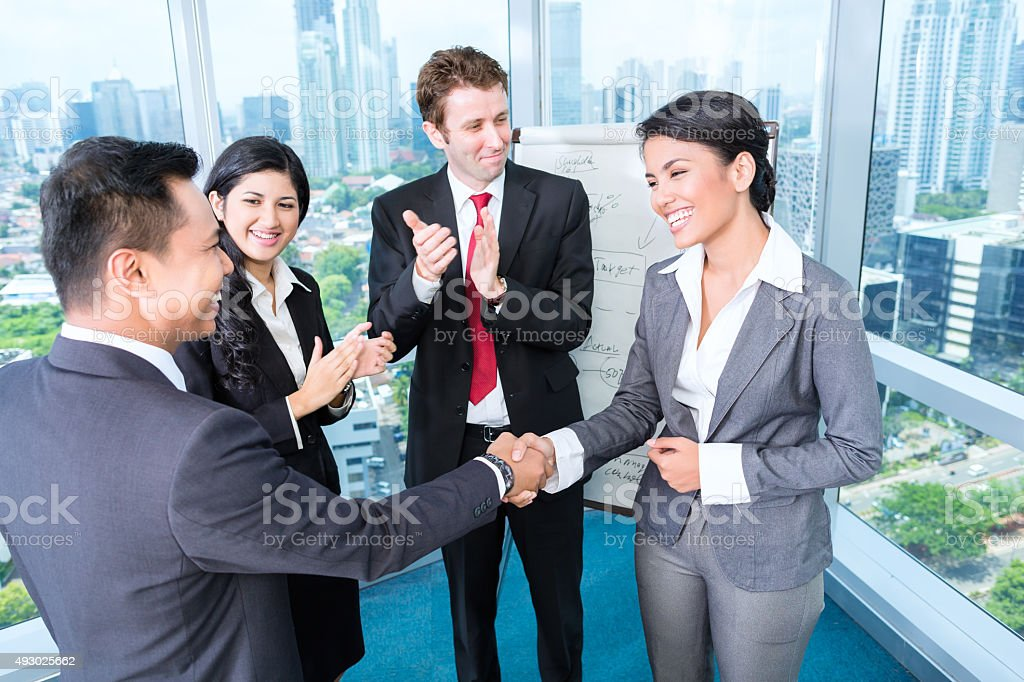 Business team applause in meeting stock photo
