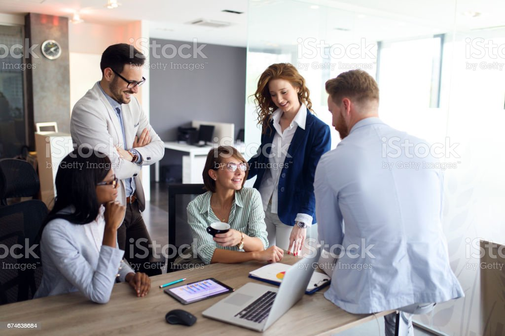 Image of a business team working together at the office.