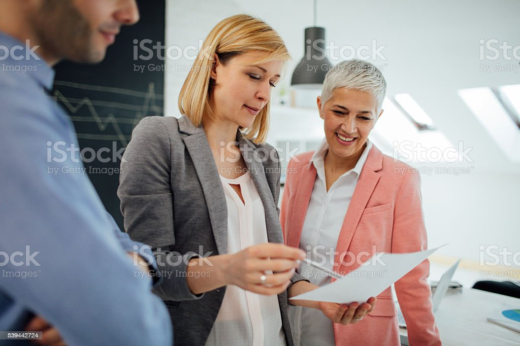 Business Team Brainstorming In Their Office. stock photo