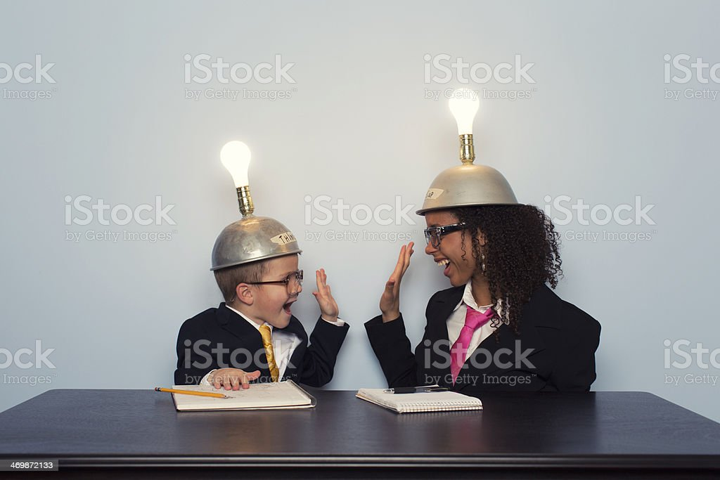 Business Team Celebrates wearing Mind Reading Helmets stock photo