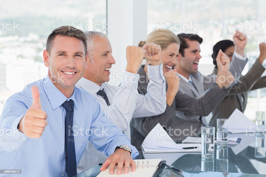 Business team celebrating a good job stock photo