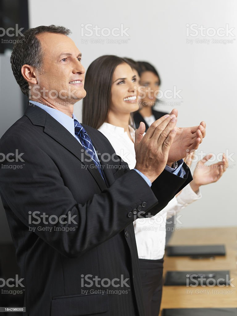 Business team clapping together royalty-free stock photo