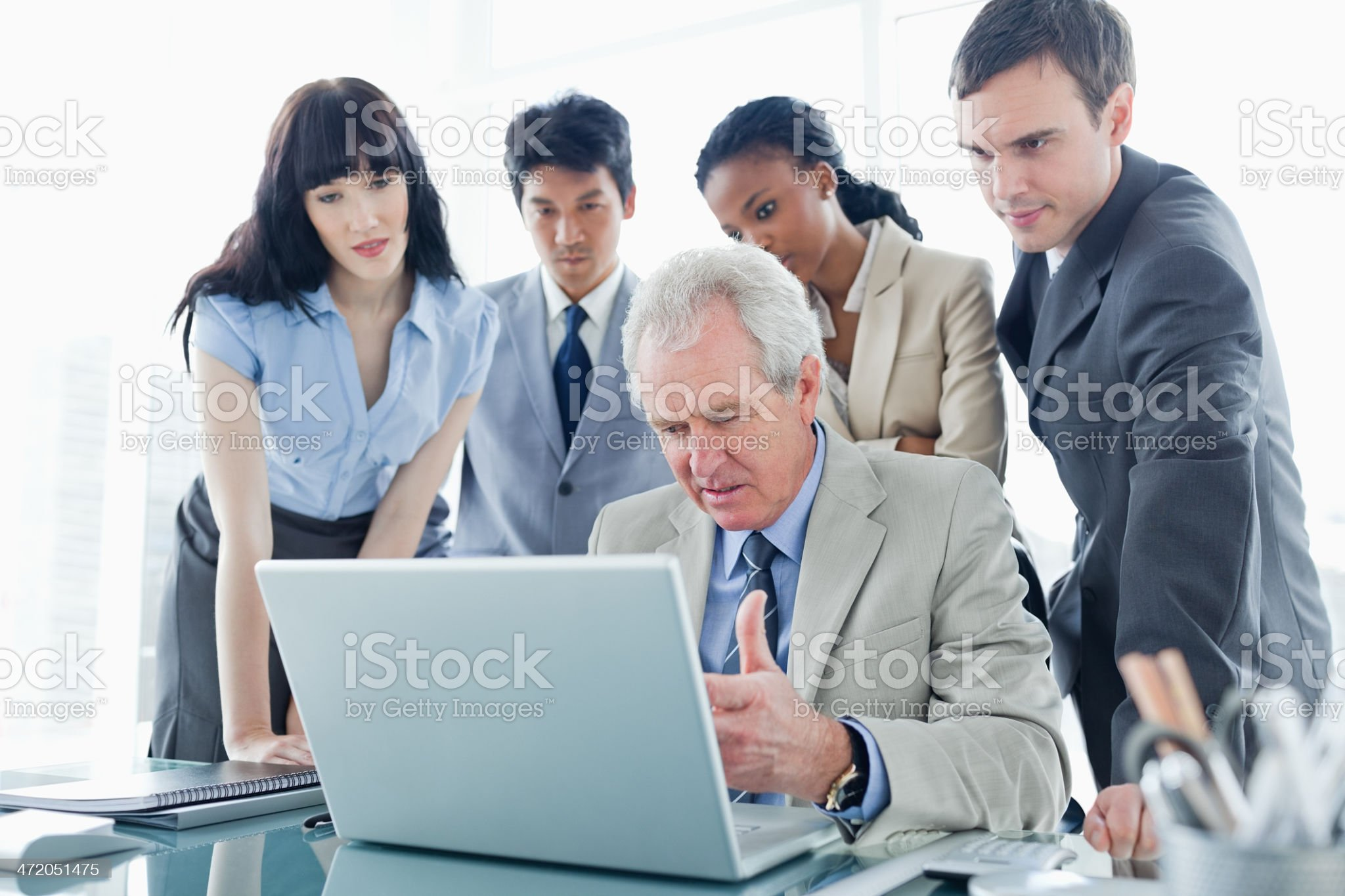 Business team concentrated on the computer while listening to th royalty-free stock photo