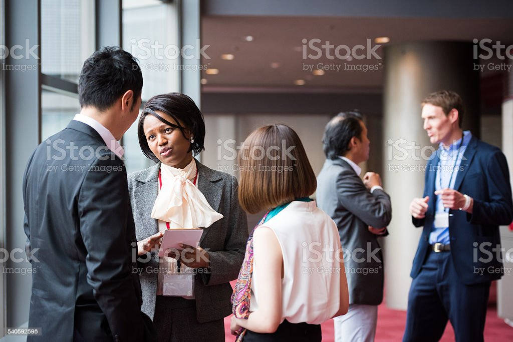 Business team consulting in the foyer at a conference stock photo
