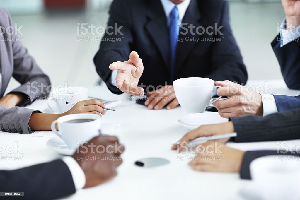 Business team conversing with each other royalty-free stock photo