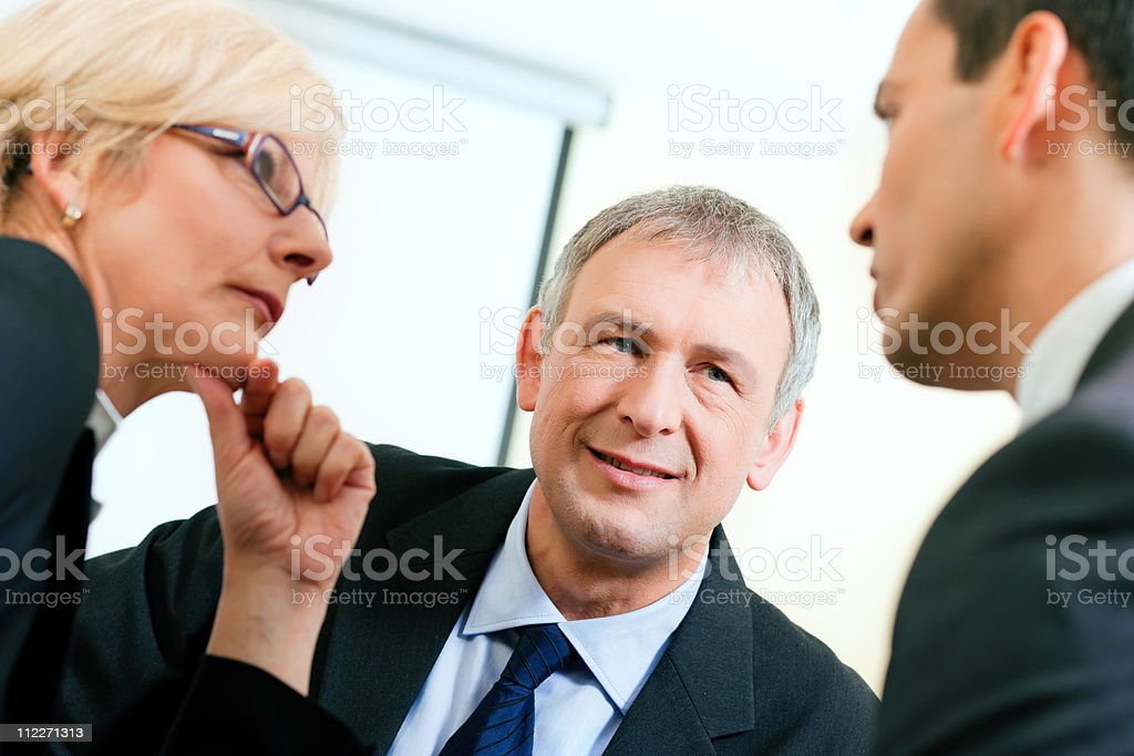 Business team discussing a project royalty-free stock photo