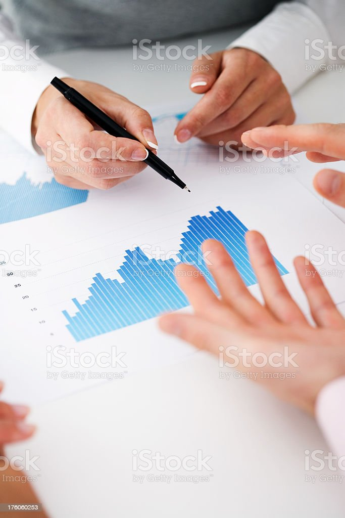 Business Team Discussing Charts Together royalty-free stock photo