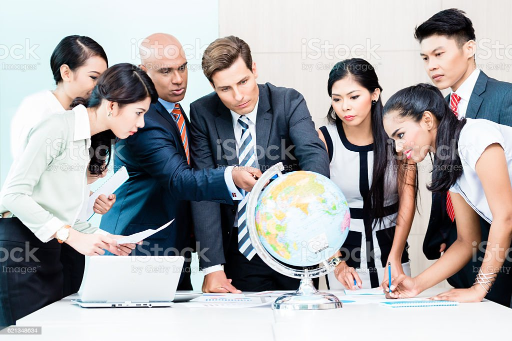 Business team discussing global market intelligence stock photo