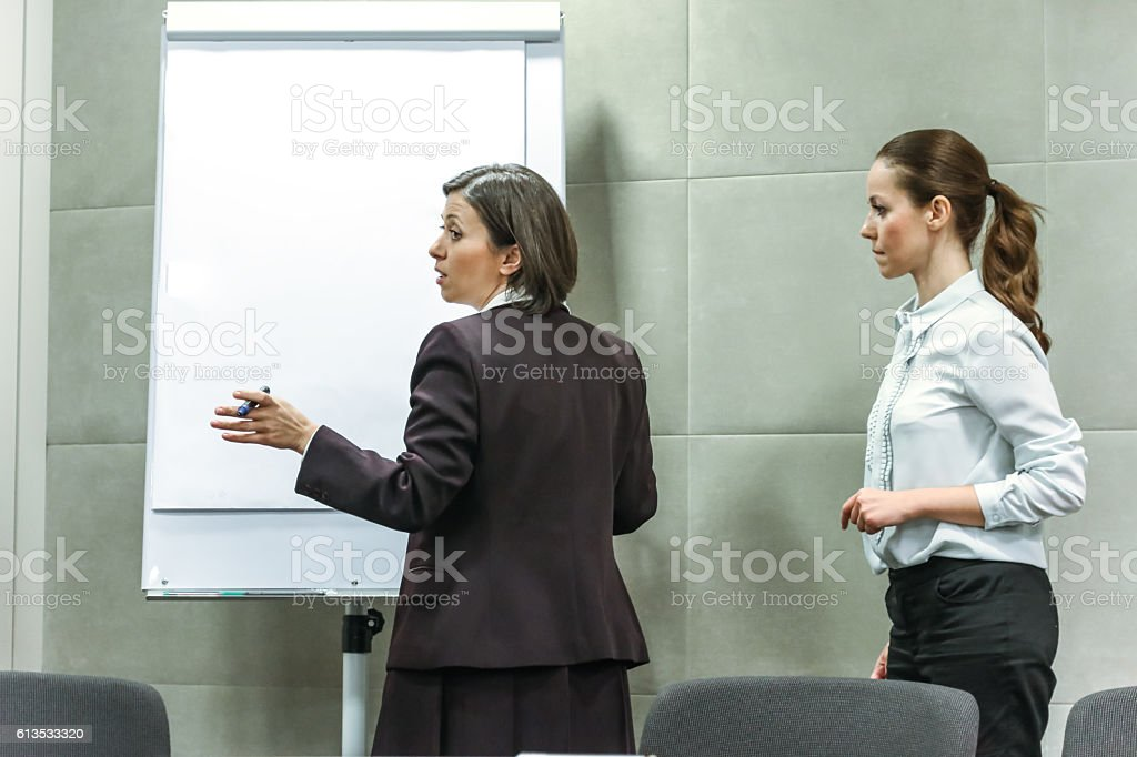 Business team discussing in a meeting stock photo