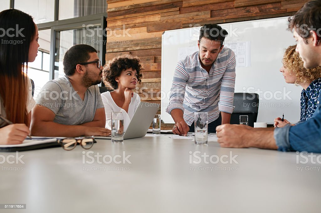 Business team discussing progress of the company stock photo