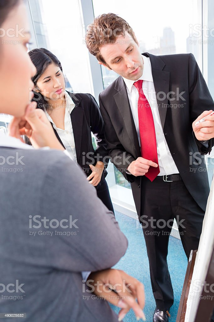 Business team drafting in strategy meeting stock photo
