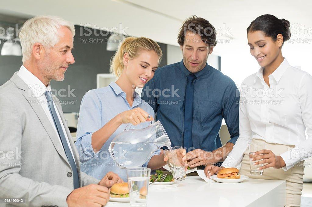 Business team enjoying lunch stock photo