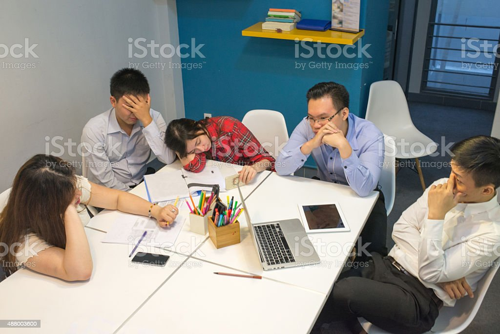 Business team feeling tired, exhausted because of serious problems stock photo
