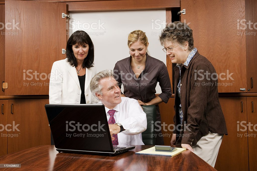 Business Team Gathered Around Laptop royalty-free stock photo