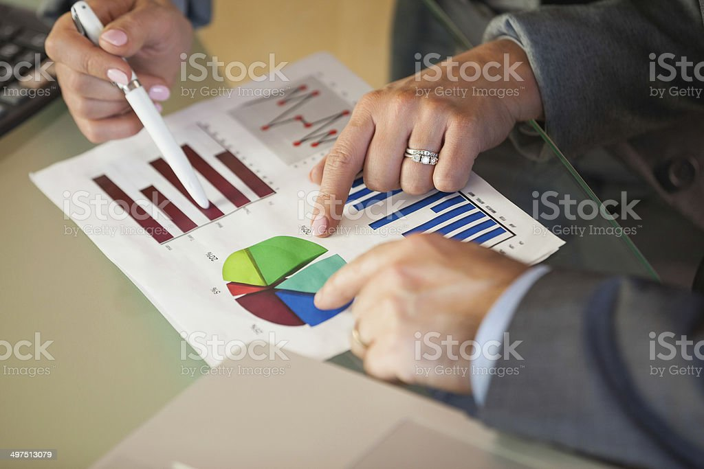 Business team going over data and graphs stock photo