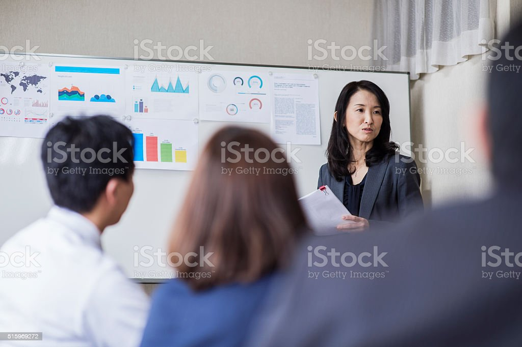 Business team having a meeting in conference room stock photo