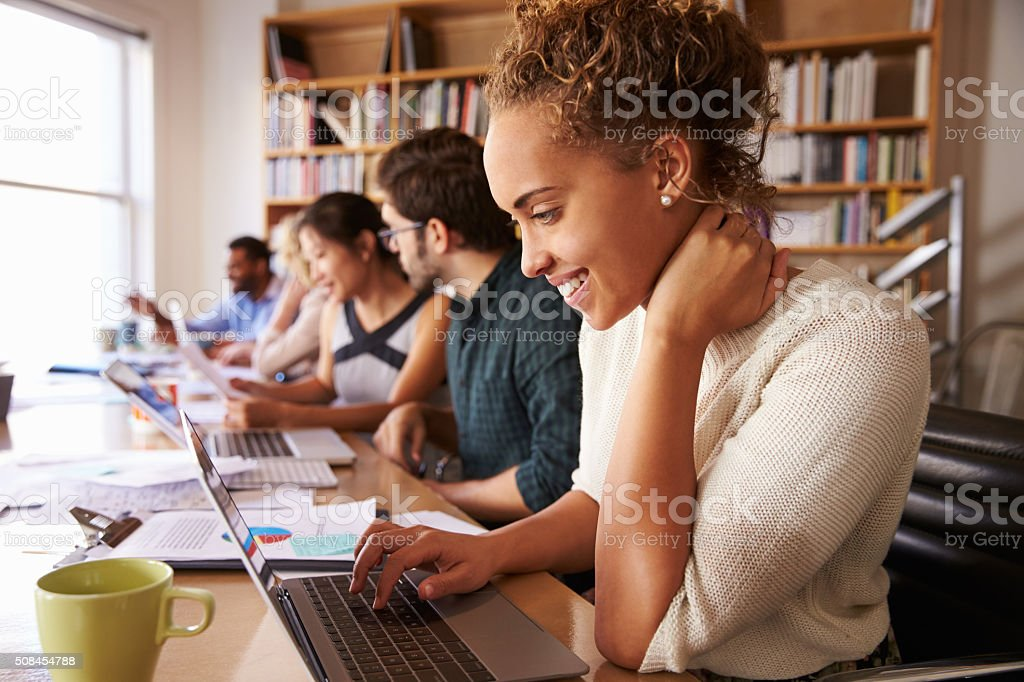 Business Team Having Meeting In Busy Office stock photo