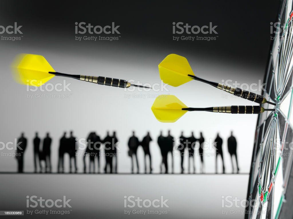 Business Team Hitting the Target and Darts royalty-free stock photo