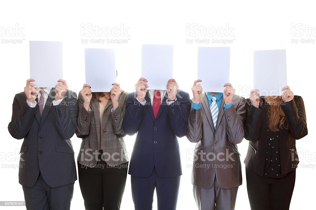 business team holding blank papers. stock photo