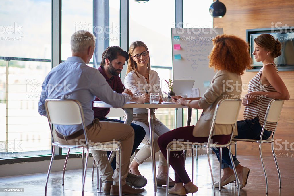 Business team in casual style in real office stock photo