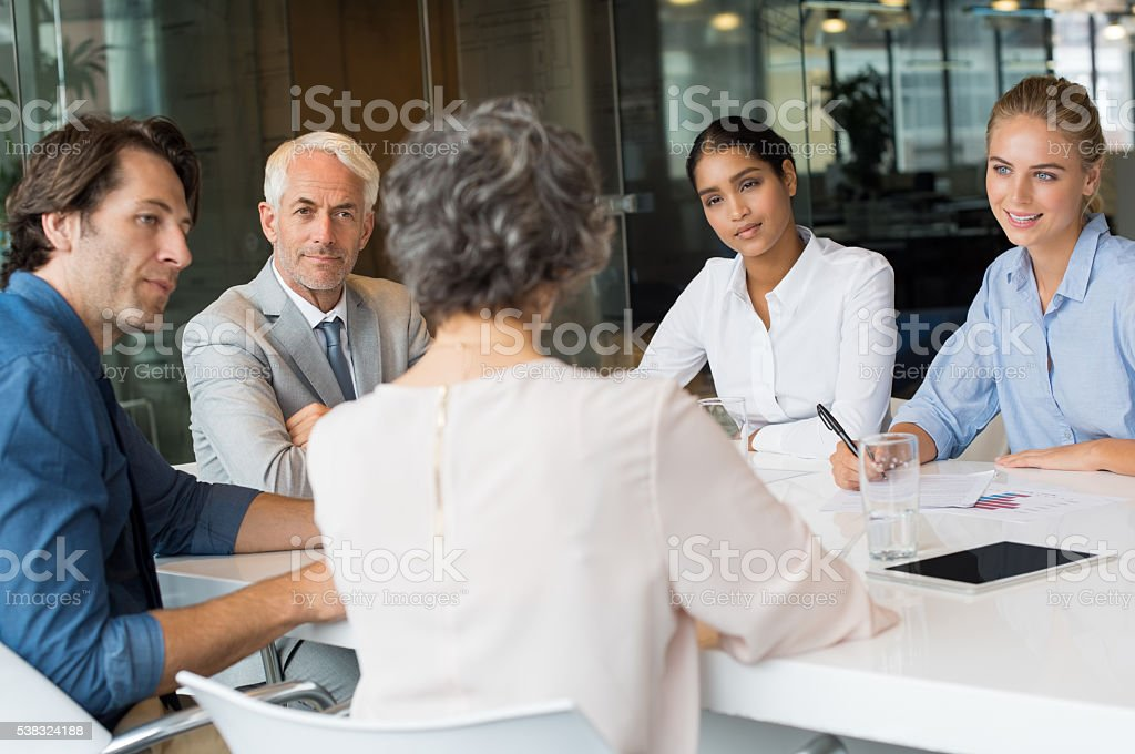 Business team in conversation stock photo