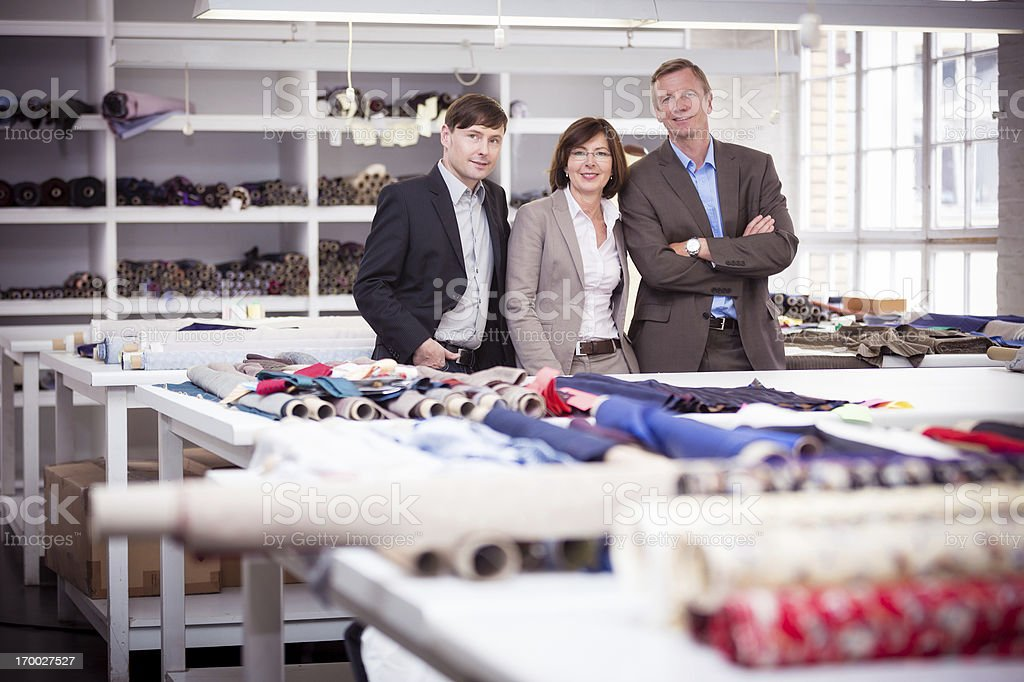 business team in fashion design workshop royalty-free stock photo