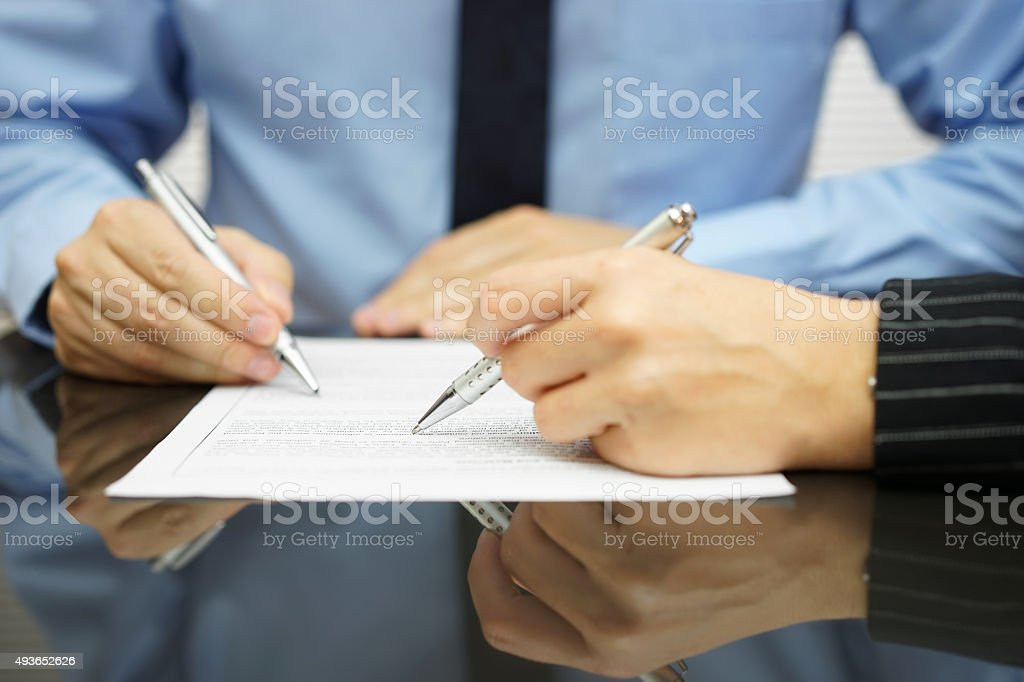 business team in meeting is working together on financial document stock photo