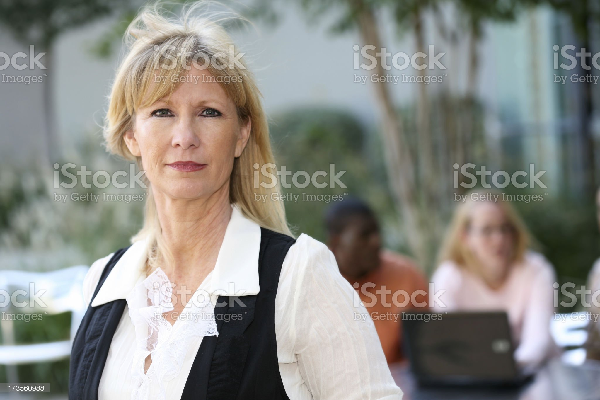 Business Team Leader Stands in Front Of Her Co-Workers royalty-free stock photo