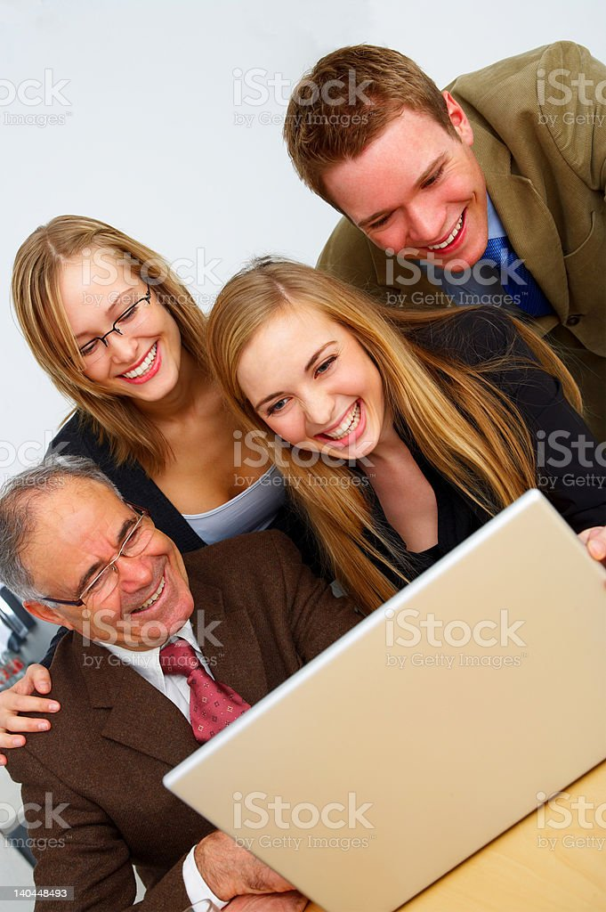 Business team looking at a laptop royalty-free stock photo