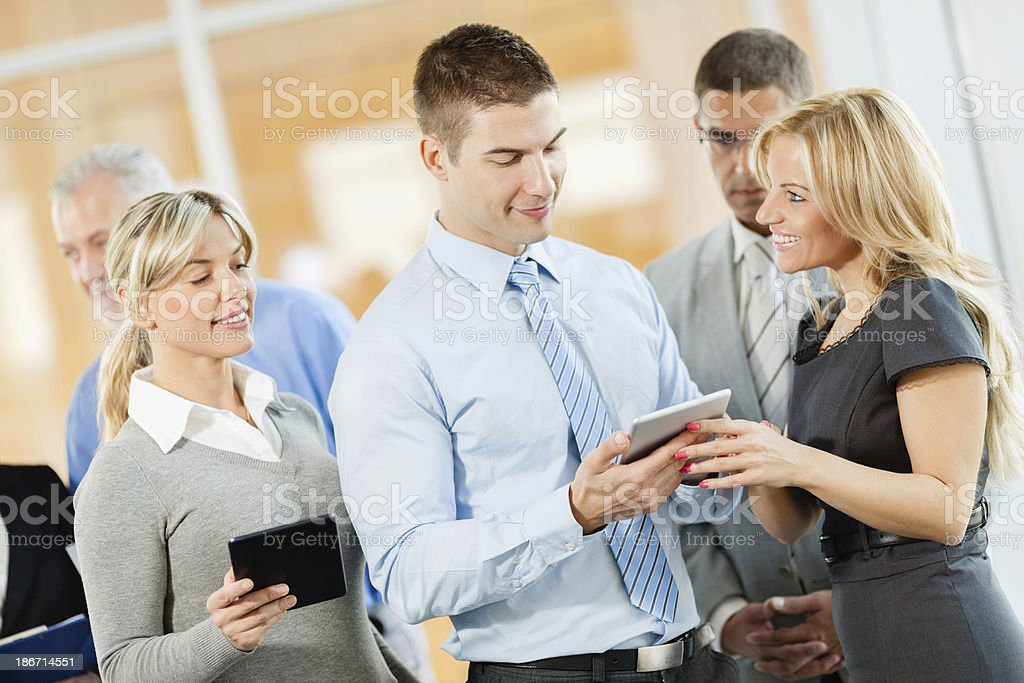 Business team looking at a pc tablet. royalty-free stock photo