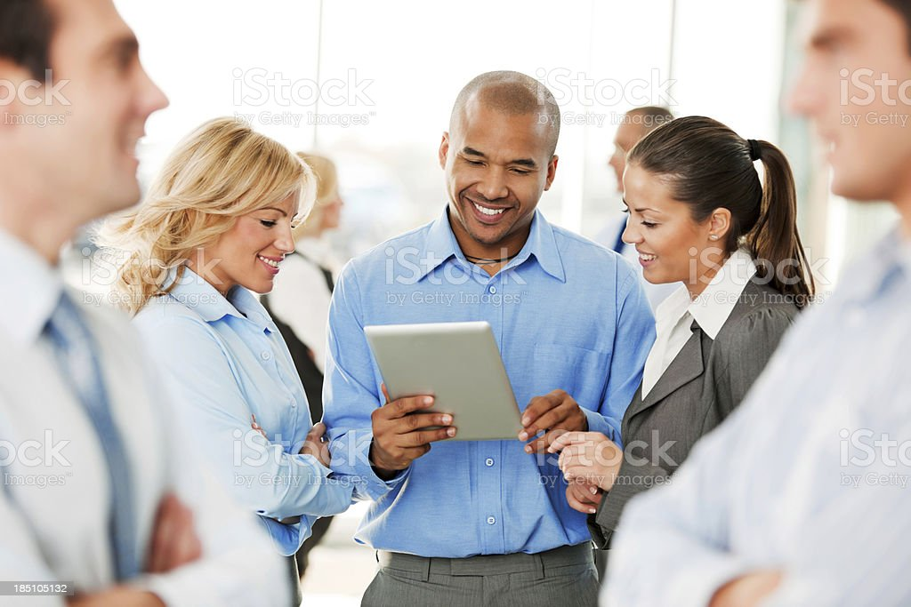 Business Team Looking at a Tablet Computer. royalty-free stock photo