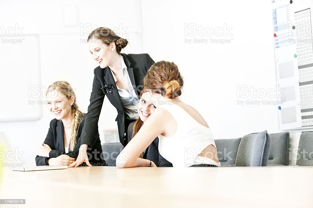 Business team looking at laptop royalty-free stock photo