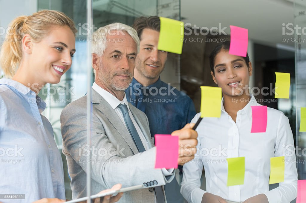 Business team looking at sticky notes stock photo