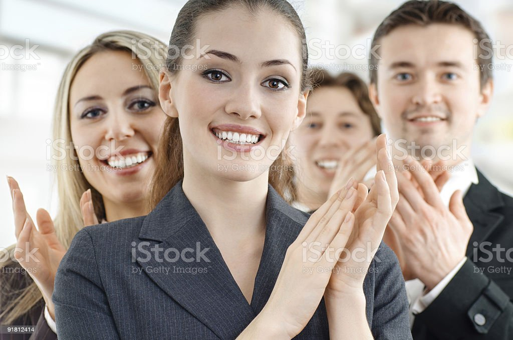 A business team looking at the camera and applauding royalty-free stock photo