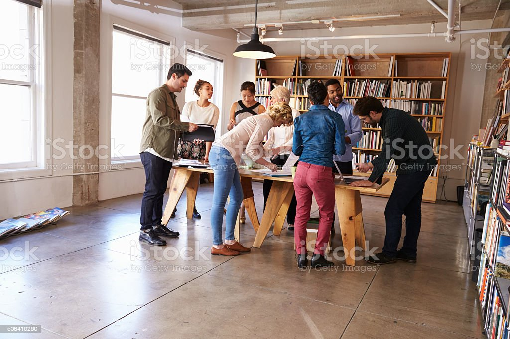 Business Team Meeting Around Table For Brainstorming Session stock photo