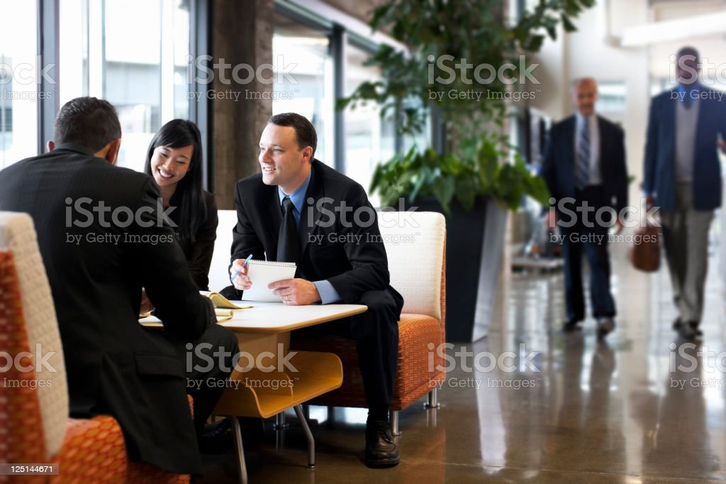 Business Team Meeting in Office Lobby, Copy Space royalty-free stock photo