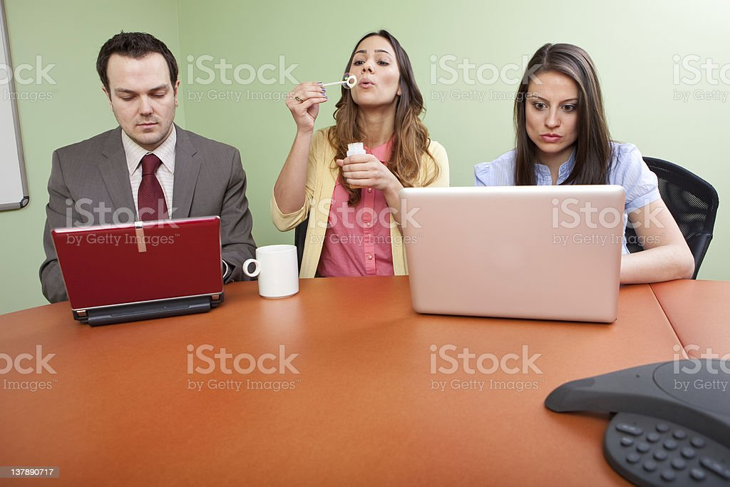 Business team member goofing off stock photo