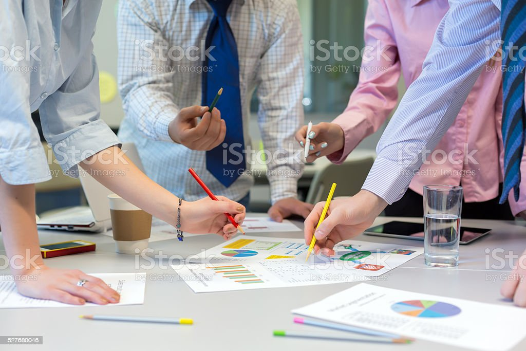 Business Team networking office Table with Charts and People Hands stock photo